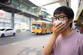 Handsomeman Wearing Face Mask Protect Filter Against Air Pollution (pm2.5) Or Wear N95 Mask. Protect poster