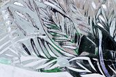 The Abstract Background Of Ice Structure. Ice Sculpture Close Up. Blue Transparent Ice Shapes. Leave poster