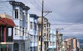 Colorful Buildings Lining A Street In The City Of San Franscisco California On An Overcast Day. poster