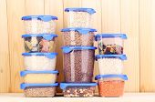 stock photo of tupperware  - Filled plastic containers on wooden background - JPG