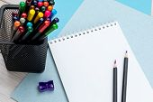Colored Pencils In A Black Office Cup, Purple Pencil Sharpener, A Pair Of Sharpened Pencils And A No poster