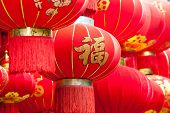Handmade Fabric red lanterns with Chinese blessing Fu on hanging for Chinese new year in a chinato poster