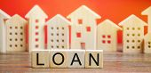 Miniature Houses With The Word Loan. The Concept Of Mortgage Housing And Real Estate Loans. Buy An A poster