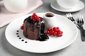 Delicious Warm Chocolate Lava Cake With Berries On Grey Table poster