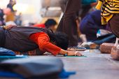Tibetan Pilgrim Prostrating Flat Ground Jokhang