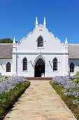 White Church In Franschhoek In Front Of Blue Sky