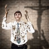 picture of repentance  - Young man coming to the Jesus cross with his dirty hands and clothes - JPG