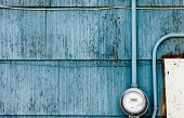 Smart grid power supply meter on grungy blue wall