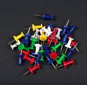 image of pushy  - Set of colourful push pins on black background - JPG