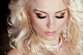 Portrait Of Beautiful Blond Girl With Make Up And Curly Hair. Jewelry And Beauty.
