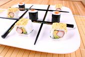 Play Tic Tac Toe With Sushi And Black Chopsticks