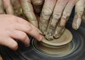 stock photo of loam  - MAKING OF POT ON POTTER - JPG