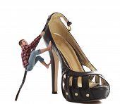 Woman Climbing A Huge Shoe