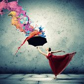 image of gymnastic  - ballet dancer in flying satin dress with umbrella under the paint - JPG