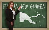 Teacher Showing Map Of Papua New Guinea On Blackboard