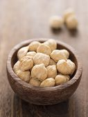 image of kukui nut  - close up of a bowl of white candlenuts - JPG
