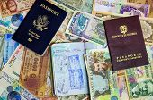 stock photo of colombian currency  - Three passports with various currencies from Latin America - JPG