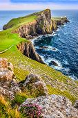 Vertical View Of Neist Point Lighthouse And Rocky Ocean Coastline, Scotland