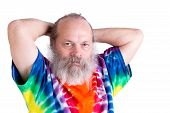 pic of hair dye  - Senior male adult man holding his hair on the back casually and looking at you in his tie dye T - JPG