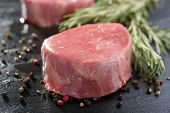 Raw Angus steak and spices
