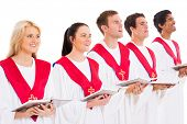 church choir members holding hymn books and singing