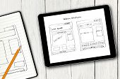 Website Wireframe Sketch On Digital Tablet Screen