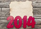 2014 New Year holiday background with old crumpled paper sheet