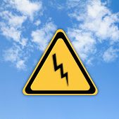 Danger High Voltage Sign On Beautiful Sky Background.
