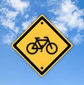 Bicycle Traffic Sign On Beautiful Sky Background.