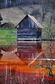 An abandoned house flooded by polluted water from a copper open cast mine