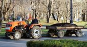 image of trailer park  - a Orange tractor with a trailer park  - JPG