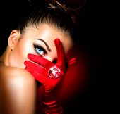 Beauty Fashion Glamorous Model Girl Portrait. Vintage Style Mysterious Woman Wearing Red Glamour Glo