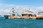stock photo of battleship  - Battleship docked in harbor Plymouth Great Britain - JPG