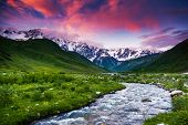Fantastic landscape and colorful overcast sky at the foot of  Mt. Shkhara. Upper Svaneti, Georgia, E