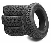 stock photo of four-wheel drive  - Stack of four new black tyres for winter car on white background  - JPG