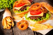 picture of burger  - Big and tasty beef burger with onion rings and french fries - JPG