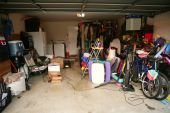stock photo of garage  - messy abandoned garage full of stuff chaos at home