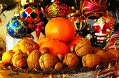 picture of hazelnut tree  - Glass plate stand topped with walnuts hazelnuts and mandarin oranges with Christmas presents under tree to the rear England UK Western Europe.
