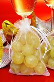 some glasses with spanish champagne and sachets with the twelve grapes of luck, traditional on the N