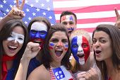 stock photo of applause  - Group of happy USA soccer fans commemorating victory yelling - JPG