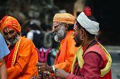 Shaiva sadhu men seeking alms in Kathmandu