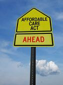 stock photo of universal sign  - conceptual sign with words affordable care act ahead over blue sky - JPG