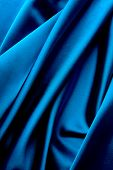 Smooth elegant dark blue satin background.