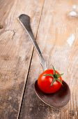 Small Cherry Tomato In A Spoon