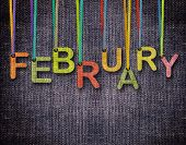 picture of february  - February letters hanging strings with blue sackcloth background - JPG