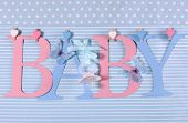 picture of girlie  - Pink and blue theme Baby bunting letters under from pegs on a line for nursery greeting card or baby shower - JPG