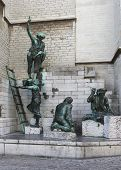 Statue Honoring Medieval Cathedral Builders In Antwerp.