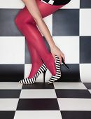image of stilettos  - Fashion concept woman wearing high heels stilettos legs close up - JPG
