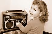 Young girl and retro radio
