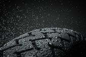 Close-up shot of classical motorcycle tire tread in wet weather condition